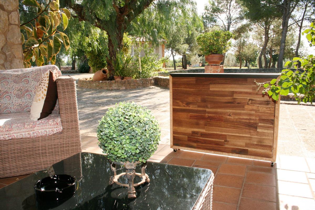 Mueble tv oculta y muebles tv de dise o a medida marquel for Muebles para terraza en madera